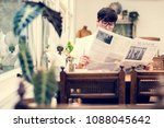 young man reading newspaper in... | Shutterstock . vector #1088045642