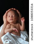 Stock photo baby in mother s arms 1088053316