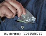 a man takes out a packet of... | Shutterstock . vector #1088055782