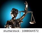 lady justice on grunge blue... | Shutterstock . vector #1088064572