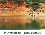 river bank with livelihood | Shutterstock . vector #1088188508