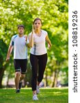 young couple jogging in park at ... | Shutterstock . vector #108819236