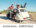 group of happy friends in a car ... | Shutterstock . vector #1088223362