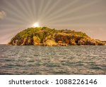 an island with sunrays  ... | Shutterstock . vector #1088226146