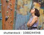 bouldering  beautiful girl look ... | Shutterstock . vector #1088244548