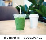 a plastic glass of iced green... | Shutterstock . vector #1088291402