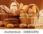 Composition with bread and rolls in wicker basket - stock photo