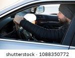 portrait of man in his car....   Shutterstock . vector #1088350772