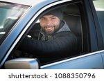 portrait of man in his car....   Shutterstock . vector #1088350796