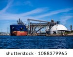 cargo ship in the port of riga... | Shutterstock . vector #1088379965