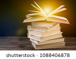 pile of books and an open book... | Shutterstock . vector #1088406878