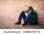 young boy sitting alone with... | Shutterstock . vector #1088478776