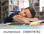 young boy sleeps on library... | Shutterstock . vector #1088478782