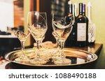 broken wine glass on a tray... | Shutterstock . vector #1088490188