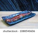 plate of long sushi nigiri ... | Shutterstock . vector #1088540606
