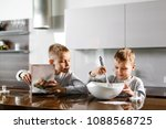 happy family in the kitchen.... | Shutterstock . vector #1088568725
