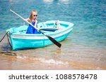 little girl in blue boat in the ...   Shutterstock . vector #1088578478