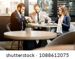 three business people having a... | Shutterstock . vector #1088612075