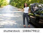 woman with car trouble trying... | Shutterstock . vector #1088679812