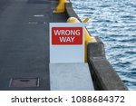 wrong way sign on wharf  | Shutterstock . vector #1088684372