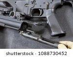gloved hand disassembling an ar ...   Shutterstock . vector #1088730452