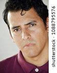 Small photo of Unemotional Hispanic Male