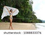 asian tanned skin girl stand on ... | Shutterstock . vector #1088833376