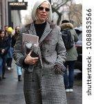 Small photo of MILAN, Italy- February 22 2018:Linda Fargo on the street during the Milan Fashion Week