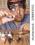 male jeweler looking through a... | Shutterstock . vector #108893552