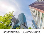 fresh green and buildings in... | Shutterstock . vector #1089002045