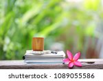 brown vintage cup with books at ... | Shutterstock . vector #1089055586