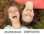 happy teenagers friends lying... | Shutterstock . vector #108910352