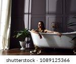 young beautiful woman sitting...   Shutterstock . vector #1089125366