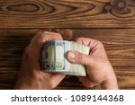 man checking a thick stack of... | Shutterstock . vector #1089144368