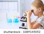 schoolgirl looking through... | Shutterstock . vector #1089145052