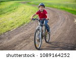 boy in red shirt ride on bike... | Shutterstock . vector #1089164252