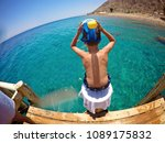 the boy jumps from the bridge... | Shutterstock . vector #1089175832