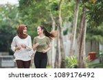 happy young asian women working ... | Shutterstock . vector #1089176492
