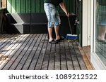 a man is spring cleaning by... | Shutterstock . vector #1089212522