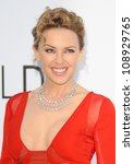 Small photo of Kylie Minogue arriving for AmfAR's Cinema Against Aids gala 2012 during the 65th annual Cannes Film Festival Cannes, France. 24/05/2012 Picture by: Henry Harris / Featureflash