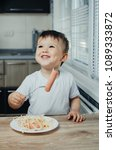 beautiful baby eating sausage... | Shutterstock . vector #1089333872
