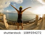 woman with arms outstretched at ... | Shutterstock . vector #1089354272