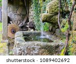 fountain with farming implements | Shutterstock . vector #1089402692