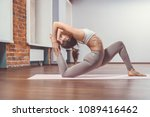 young girl practicing yoga in... | Shutterstock . vector #1089416462