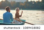 young couple in a boat on a... | Shutterstock . vector #1089418082