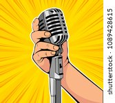 hand hold microphone cartoon... | Shutterstock .eps vector #1089428615