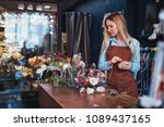 young florist in an apron in... | Shutterstock . vector #1089437165