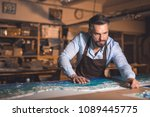 mature man in an apron in studio | Shutterstock . vector #1089445775