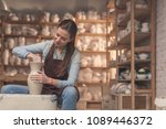 young girl working on a potter... | Shutterstock . vector #1089446372