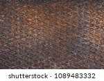 textured metal surface covered... | Shutterstock . vector #1089483332